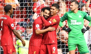 Liverpool's Mohamed Salah (centre left) celebrates with Roberto Firmino after scoring the team's third goal.