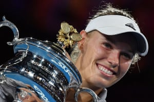 Denmark's Caroline Wozniacki poses with the winner's trophy after beating Romania's Simona Halep in their women's singles final match on day 13 of the Australian Open tennis tournament in Melbourne