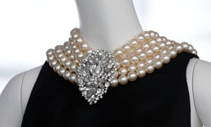 The black satin sheath with integral pearl necklace worn by Audrey Hepburn in the film Breakfast at Tiffany's.