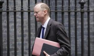 Chris Whitty walking through Downing Street.