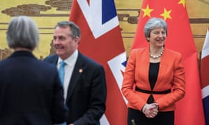 Liam Fox and Theresa May during a signing ceremony at the Great Hall of The People in Beijing.