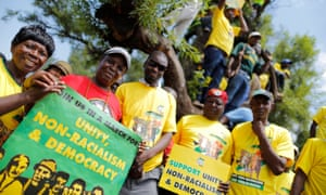African National Congress (ANC) supporters gather with their placards at an anti racism march, during which the secretary general accused the US of mobilising for regime change.
