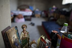 A statuette of Jesus stands in an abandoned home taken over by FUPCEG vigilantes in Chichihualco.