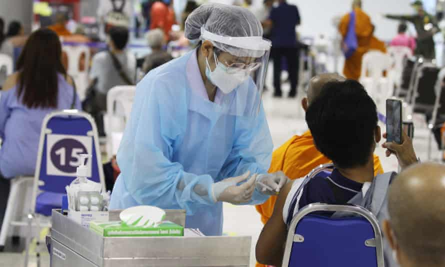 A health official administers a Covid vaccine dose at a vaccination centre inside the Bang Sue Grand Station in Bangkok