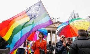 Thousands of people gather in Melbourne on Sunday in support of same-sex marriage. At least half of Australians have already voted in the postal survey.