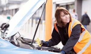 Halfords employee checks a car