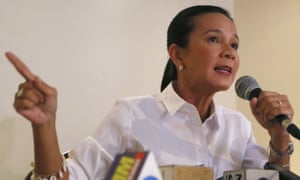 Presidential candidate Grace Poe gestures during a news conference a few days before the election.
