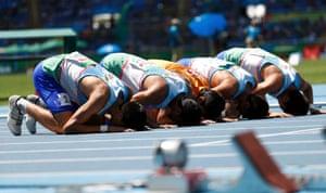 The Uzbekistan team pray following their bronze medal finish in the men's 4x100m T11-13 final