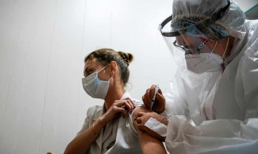 A medic of the regional hospital receives Russia's Sputnik-V vaccine