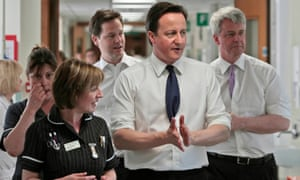 David Cameron, Nick Clegg and Andrew Lansley speaking with staff at Frimley Park hospital in 2011.
