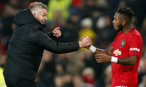 Manchester United's manager, Ole Gunnar Solskjær celebrates the win over Tottenham with Fred.