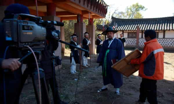Performers wait to film a show at a period film set in Pyongyang in 2011.