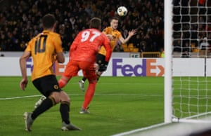 Wolverhampton Wanderers' Diogo Jota scores their first goal.