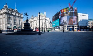 A deserted Piccadilly Circus during morning rush hour in central London on Thursday.