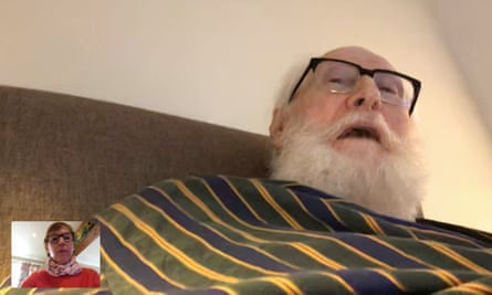 Anne Cowan video calling her husband, Andrew, in his care home.