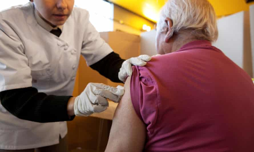 A nurse administers a flu vaccine