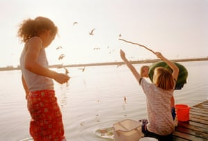 Children go crab-fishing. Taken from Looking for Love 1978-2003