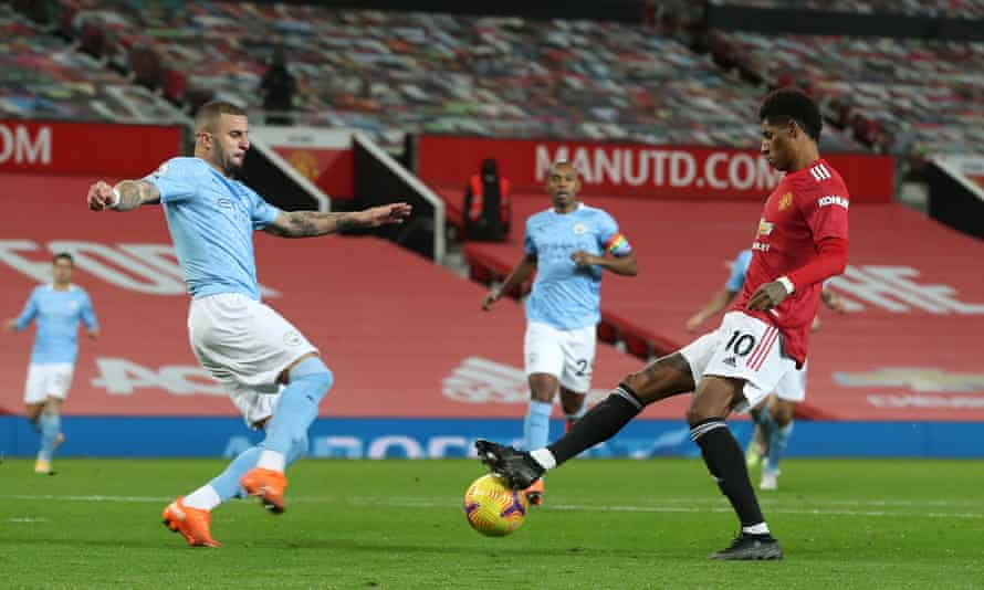 Kyle Walker lunges in on Marcus Rashford for a penalty which was overturned by VAR for an offside. It was one of the few incidents in an awful Manchester derby.