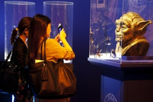 People photograph Yoda in Tokyo
