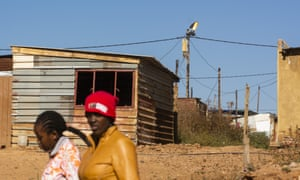 Electricity cables above residential shacks in the Atteridgeville township, Pretoria, South Africa.