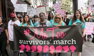Demonstrators march at a #MeToo rally in Beverly Hills, California.
