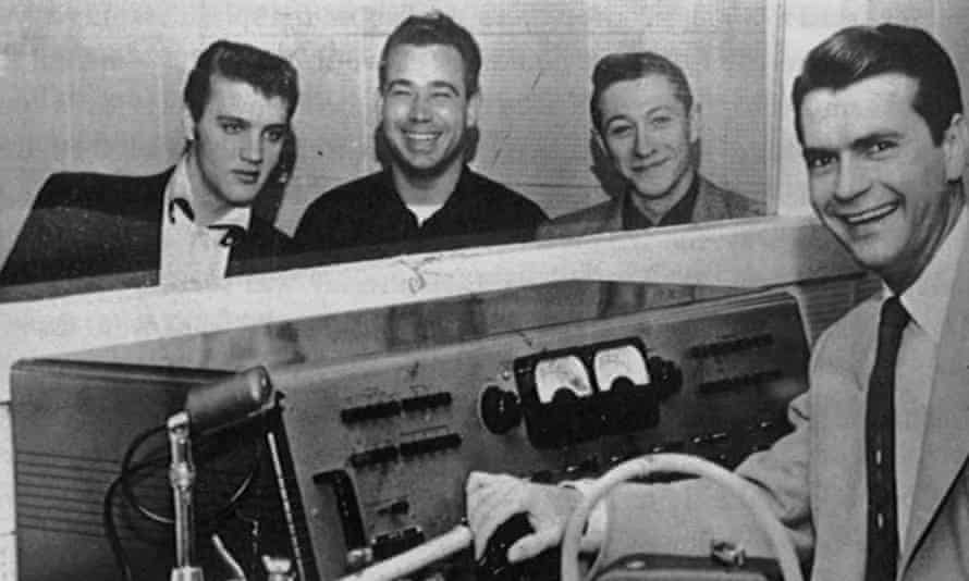 Scotty Moore, second from right, with, from left, Elvis Presley, Bill Black and Sam Phillips during a recording session at Sun Records in Memphis, Tennessee, 1954.