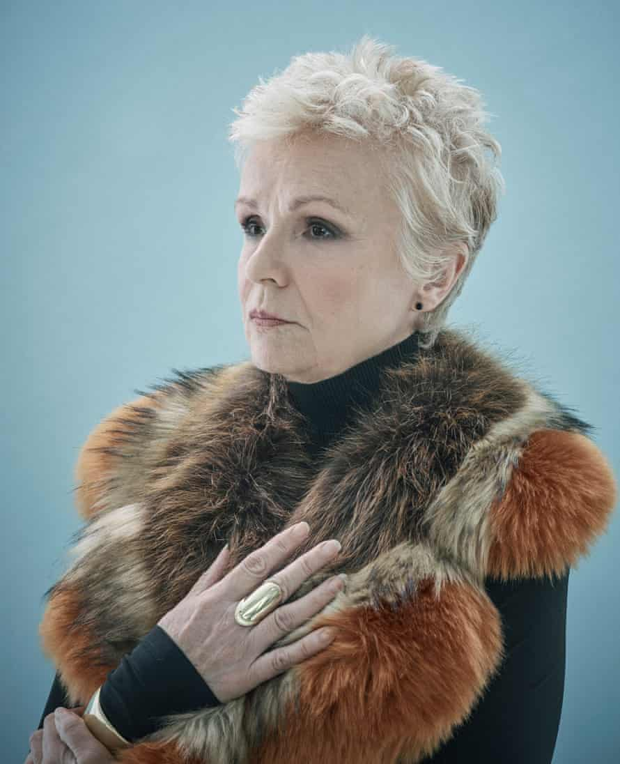 Julie Walters wears a roll-neck by Sportmax, a fake fur collar by Marc Cain and a ring and bangle by Minas.