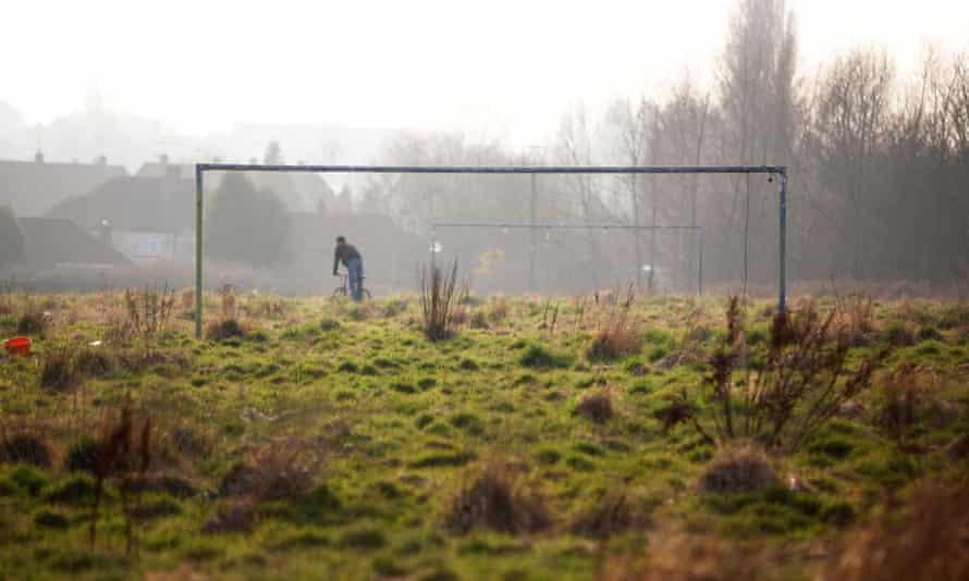 An overgrown and abandoned football pitch