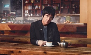 Johnny Marr enjoying a cup of tea at Soup Kitchen, Manchester