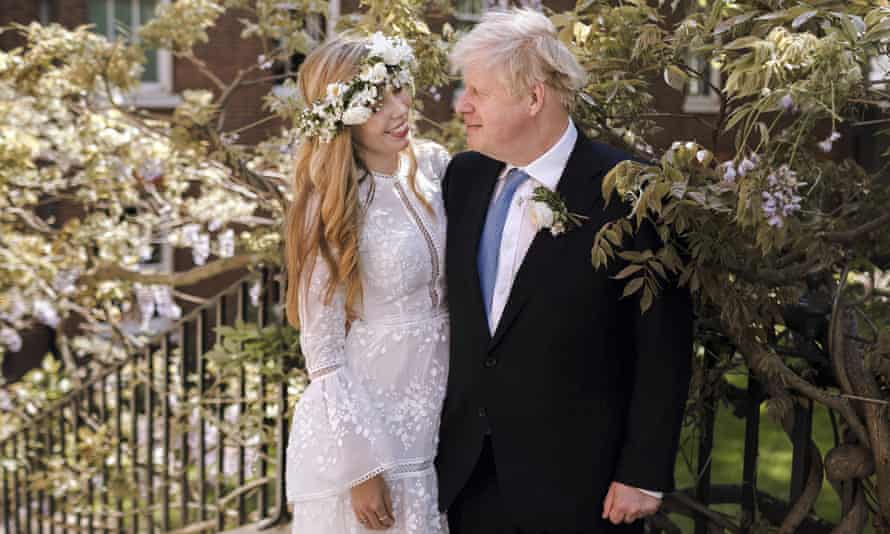 Boris Johnson and Carrie Symonds pose together for a photo in the garden of 10 Downing Street after their wedding on Saturday.