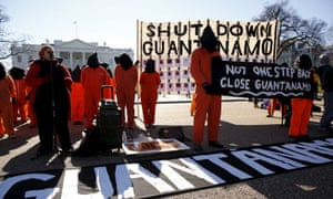 Protesters in orange jumpsuits rally outside the White House to demand the closure of the US prison at Guantanamo Bay.