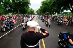 US Marine Tim Chambers salutes as participants in the Rolling Thunder annual motorcycle rally ride in Washington DC