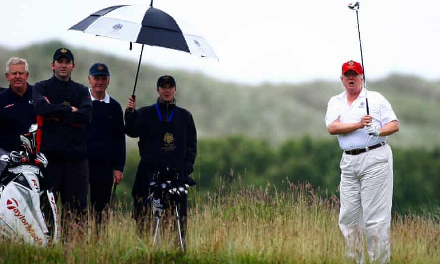 Donald Trump plays golf at the opening of his Trump International Golf Links golf course near Aberdeen in 2012