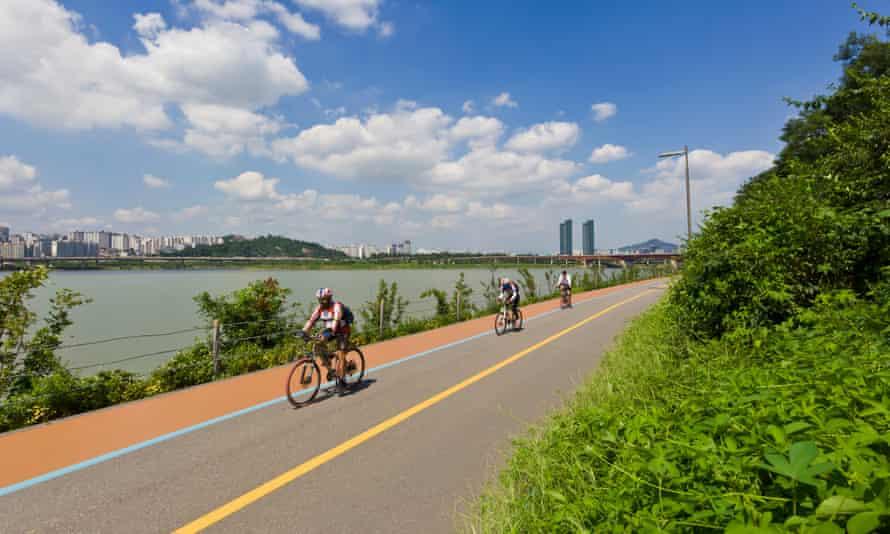 Cycling by the Seongsudaegyo Bridge Hangang river, Seoul, South Korea