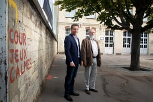 Sébastien Maire, the chief resilience officer of Paris (left), and Stephan Lajous, head of the 20th arrondissement architecture section, in the schoolyard of École Riblette.