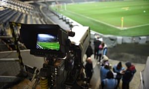 A TV camera is poised to film an English Premier League match. Sport is a major driver of pay-TV subscriptions.
