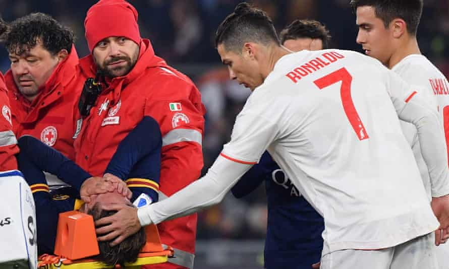 Cristiano Ronaldo attempts to console Nicolo Zaniolo after the Italian rupturing his anterior cruciate ligament during Roma's defeat to Juventus.
