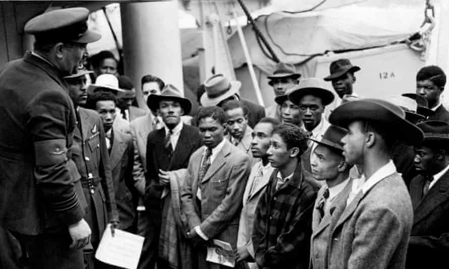 Jamaican immigrants welcomed by RAF officials after disembarking from the Empire Windrush at Tilbury.