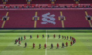 The Liverpool players, back in training after lockdown, take a knee at Anfield in memory of George Floyd.