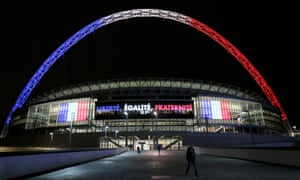 The Wembley arch is lit in the colours of the French flag after terror attacks in Paris. 'Its like a symbol of our country,' says one England fan.