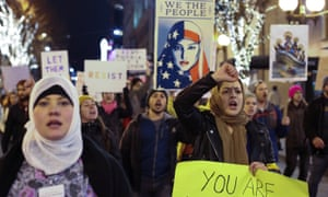 People march through downtown Seattle during a protest held in response to Donald Trump's travel ban.