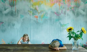 Milla, seven, and Ossian, four, in front of Lee Herring's graffiti wallpaper from their company, feathr.com.