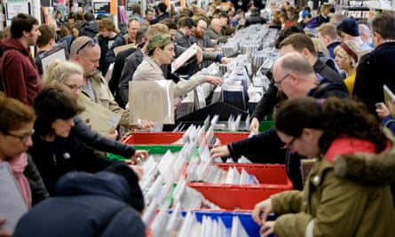 Customers look through racks of vinyl records at Rough Trade East in London on 19 April 2014, Record Store Day.