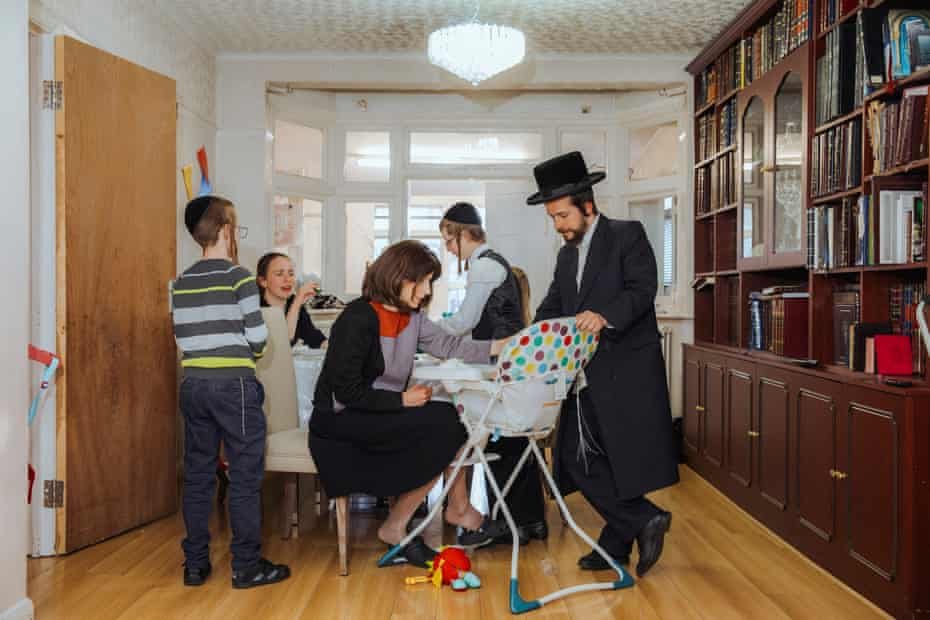 Shlomo and Malky Davidovits feed Gitty, their youngest child