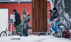 Refugees walk to the Norwegian border crossing station at Storskog after crossing the border from Russia