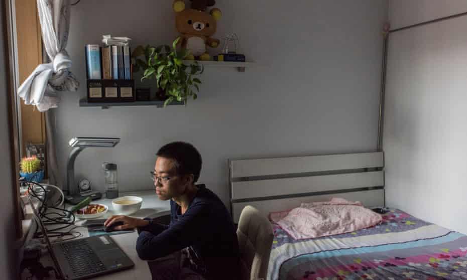 Yuan Qi in his bedroom at his parents' apartment.