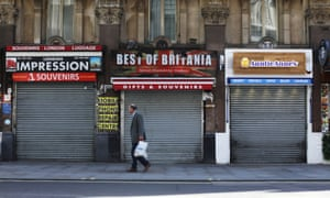 A lone pedestrian in central London passing a row of shuttered shops on 7 May, as most retailers  remained locked down.