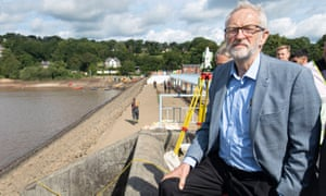 The Labour leader, Jeremy Corbyn, looks at the Toddbrook reservoir