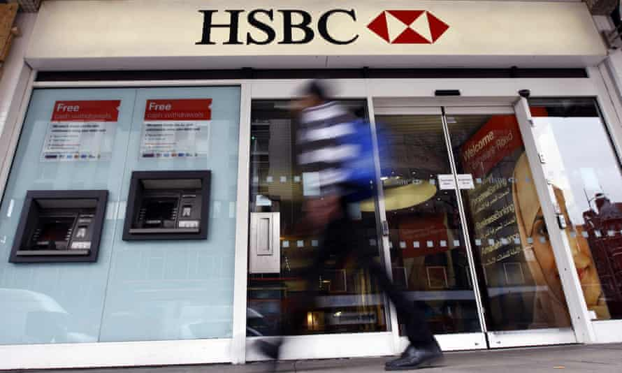 A man passes a branch of HSBC bank in London.