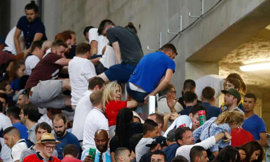 England fans scale a wall to try to escape the violence that followed the game in Marseille.